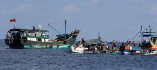 Pescatori cinesi e filippini