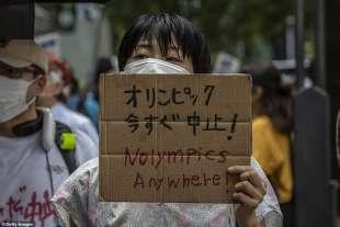 proteste olimpiadi tokyo 2020 10