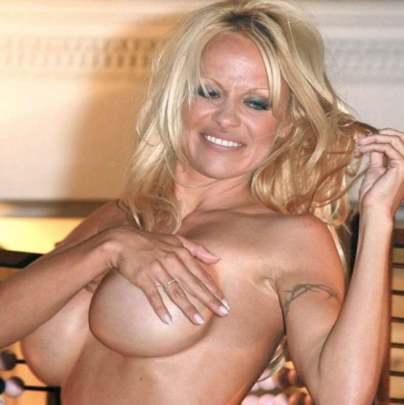 Pamela anderson strips to a nude bodysuit for bizarre dance performance