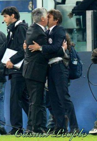 Did Carlo Anceltotti & Antonio Conte kiss after Juventus 2   Real Madrid 2?! [Crazy picture]